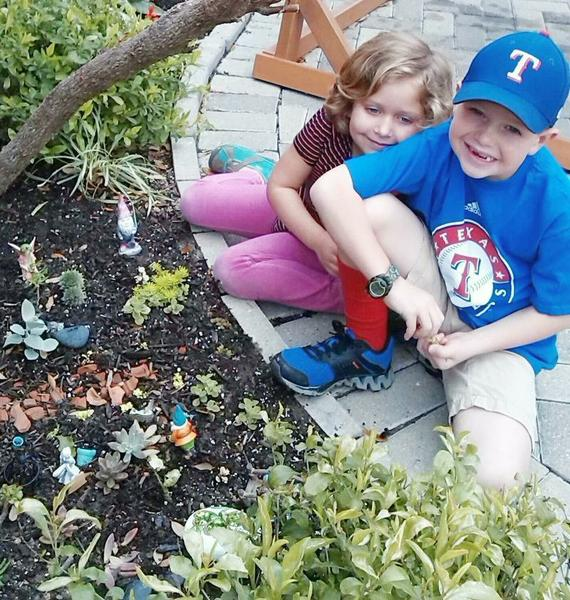 Emersyn and Brody Playing in Fairy Garden