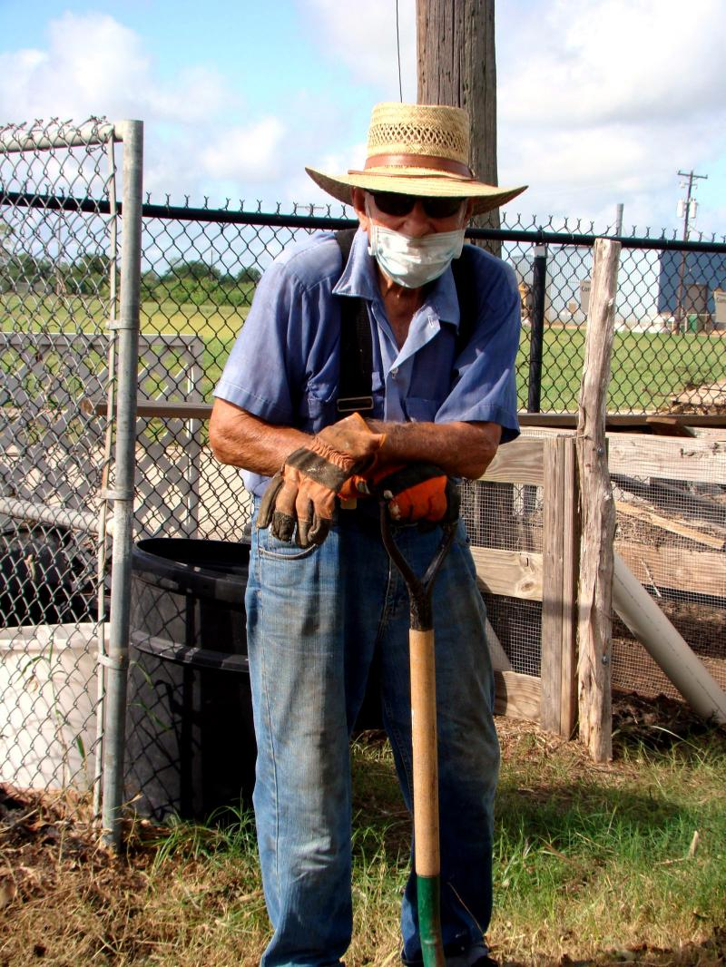 Ed Gregurek Longtime Master Gardener wears protective gear to work at VEG