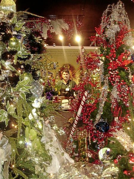Designer John Moraida, 67, is nestled with holiday decor at Devereux Gardens