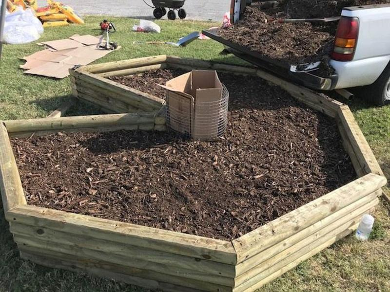Keyhole Garden with compost and commercial bedding